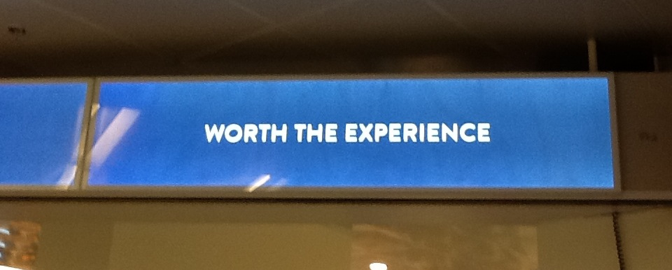 Banner above checkouts reading: Experience Iceland. This is Iceland at it's purest. Come and Experience Iceland.